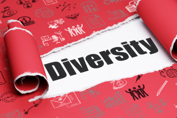 """Aufgerissenes Geschenk,, darin steht """"Diversität"""""""